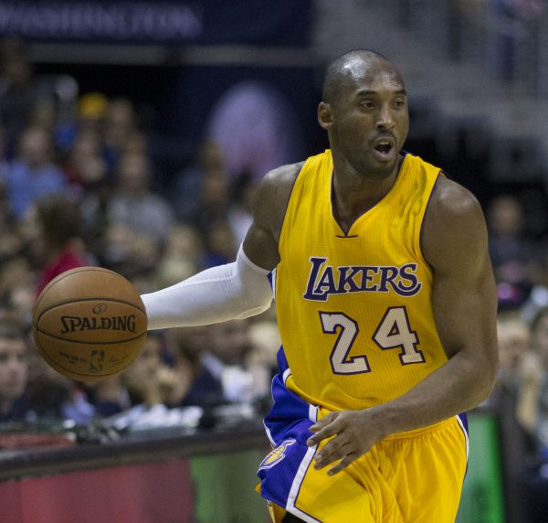 Kobe Bryant with Spalding Official NBA Game Ball